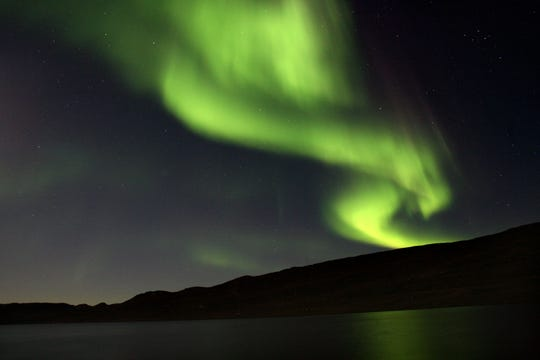 The Aurora Borealis, otherwise known as the northern lights, most often occur from September to October and from March to April in Greenland. They are a popular tourist attraction, but can not be seen during the summer months.
