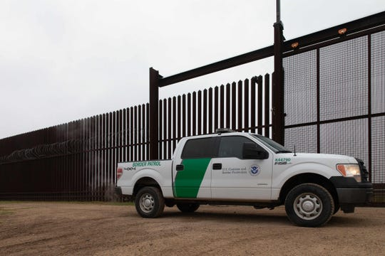 In this file photo taken on January 15, 2019, a US Customs and Border Protection vehicle drives at the gate of the border fence at the US-Mexican border in McAllen, Texas.