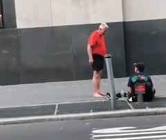 Runner gives man sitting on sidewalk his shoes then walks barefoot through New York City