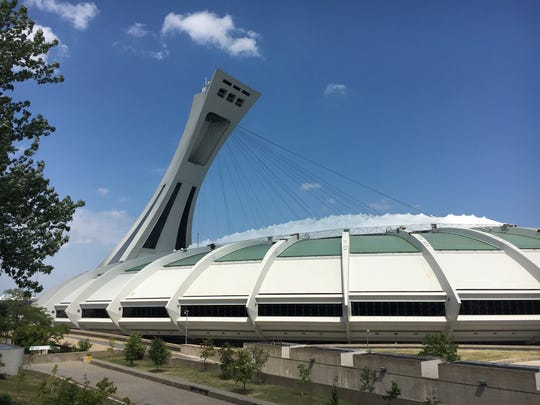 Olympic Stadium and Montreal Tower, the world's tallest inclining tower.