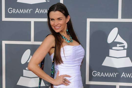 In this Feb. 12, 2012, file photo, Alicia Arden arrives on the red carpet at the 54th annual Grammy Awards in Los Angeles.