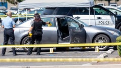 Police investigate a car where a retired Cal State Fullerton administrator was stabbed to death Monday, August 19, 2019 in Fullerton, Calif.