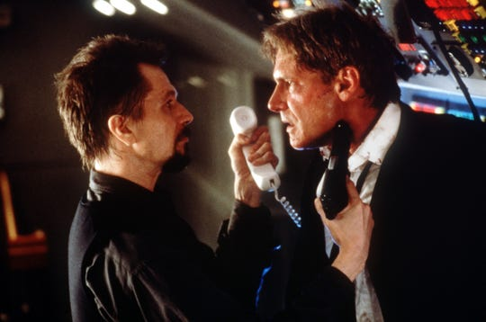 """Harrison Ford (right) is the president and Gary Oldman is the Russian terrorist who won't get off his plane in """"Air Force One."""""""