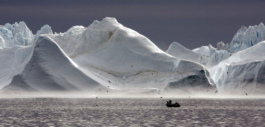 Disko Bay is home to gigantic icebergs, located on the western coast of Greenland.