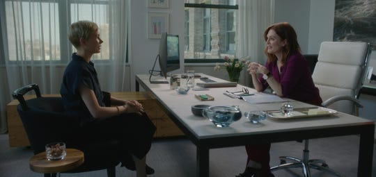 "Michelle Williams as Isabel, left, and Julianne Moore as Theresa Young in a scene from ""After the Wedding."""