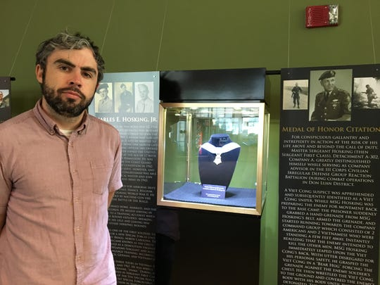 Greg Waters, curator at the NJ Vietnam Veterans' Memorial in Holmdel, assembled the 'Above and Beyond' exhibit featuring the Medal of Honor.