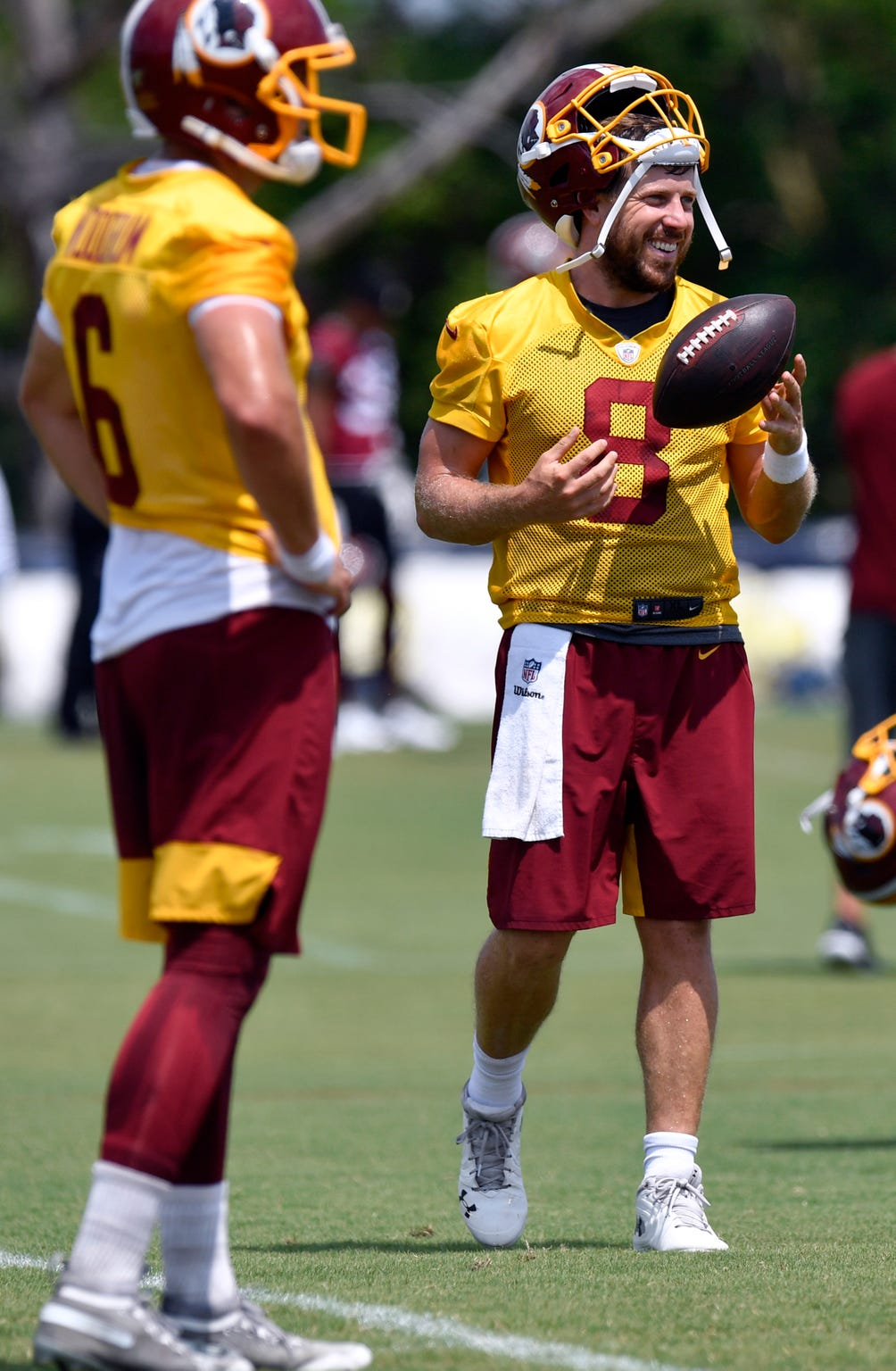 Washington Redskins quarterback Case Keenum smiles during training camp in Richmond, Va.