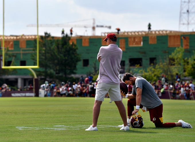 Washington Redskins quarterback Colt McCoy spends time with his father Brad after practice Tuesday at training camp in Richmond, Va. August 6, 2019. Brad McCoy was the head coach at Jim Ned High School in Tuscola in the early 2000s where Colt was also quarterback.