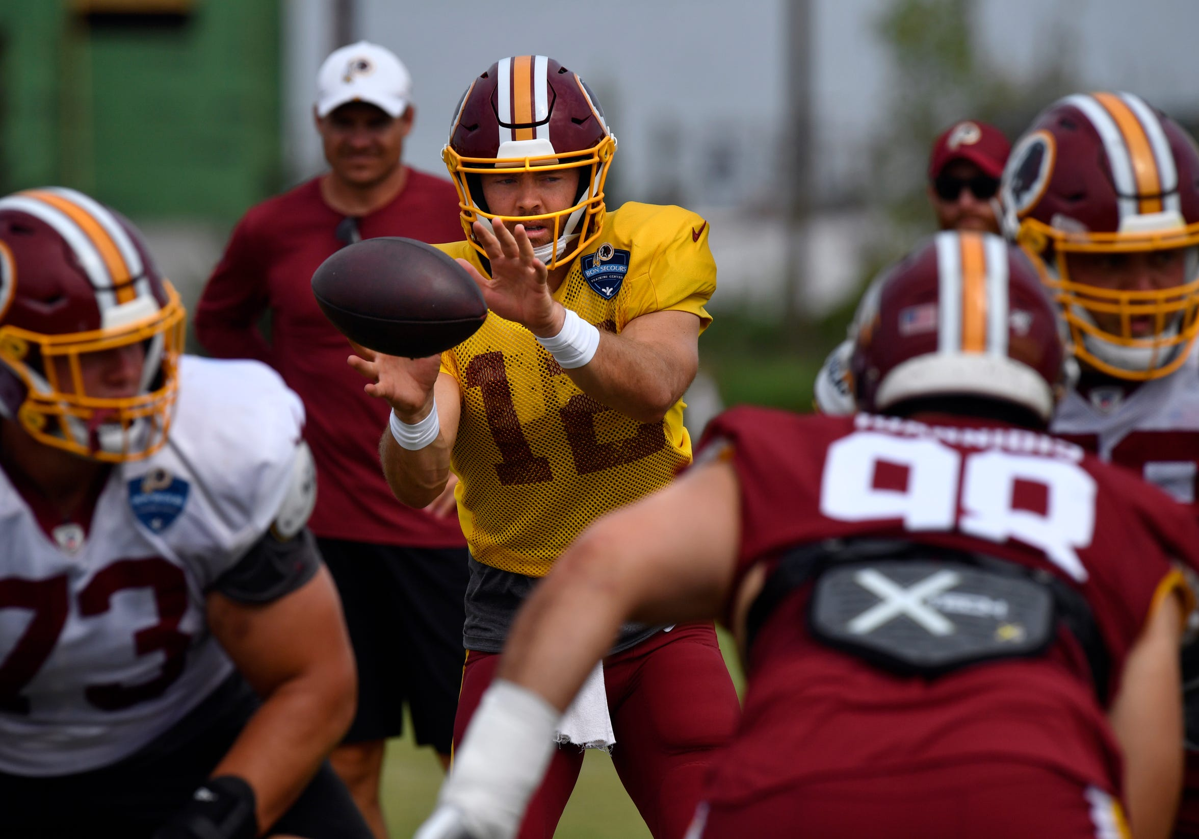 Colt McCoy catches the snapped ball during drills at Washington Redskins training camp in Richmond, Va. Monday August 5, 2019.