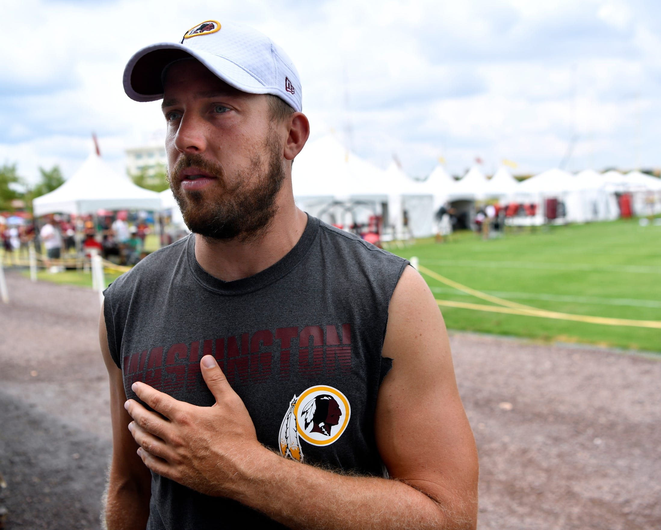Quarterback Case Keenum answers questions at the end of practice at the Washington Redskins training camp in Richmond, Va. Aug. 5.