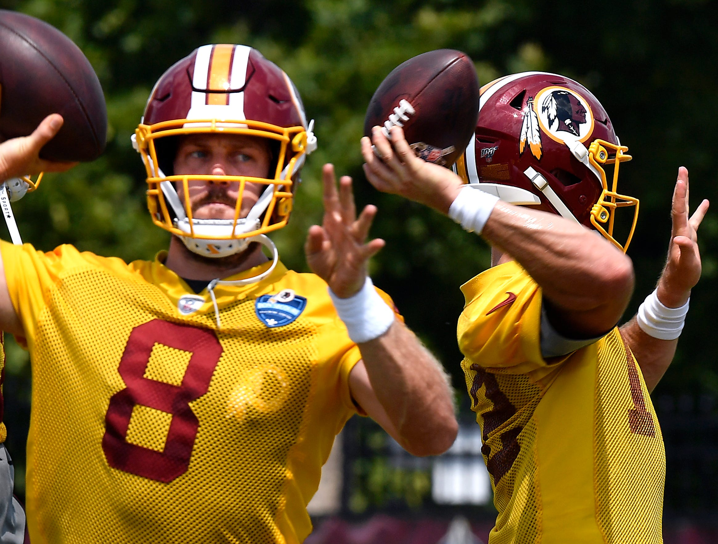 Quarterbacks Case Keenum (left) and Colt McCoy both throw passes during practice Washington Redskins training camp in Richmond, Va. Tuesday August 6, 2019. It was the last day of training camp before Thursday's pre-season game against Cleveland.