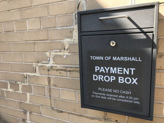 Previously patched cracks on the exterior walls of Marshall Town Hall show signs of further damage to Marshall Town Hall that could require repairs of storm drains underneath South Main Street.