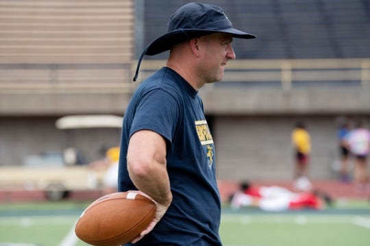 Battle Creek Central head football coach Lorin Granger conducts practice on Tuesday, Aug. 20, 2019 at Battle Creek Central High School.