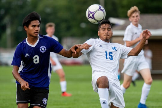 Lakeview senior Nian Kee (8) and Harper Creek junior Brian Castellanos (15) battle for the ball on Monday, Aug. 19, 2019 at Lakeview High School in Battle Creek, Mich. Lakeview defeated Harper Creek 8-0.
