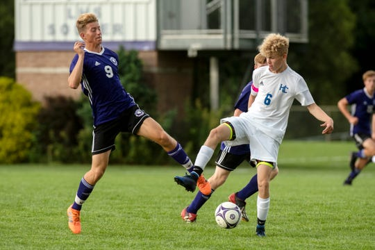 Lakeview senior Skyler Sebring (9) and Harper Creek junior Garrison Bliler (6) battle for the ball on Monday, Aug. 19, 2019 at Lakeview High School in Battle Creek, Mich. Lakeview defeated Harper Creek 8-0.