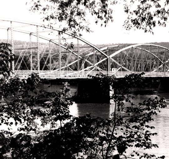 A 1930s photograph by Jack Warner of the Washington Street Bridge, which still stands today.