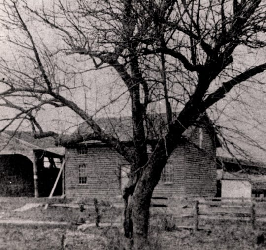 An 1860s photograph of the covered toll bridge over the Susquehanna River with the toll house on the right.