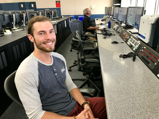 Sporting a 'man-bun' and a baseball style henley, 24 yr. old Connor Murphy is part of the next generation of aerospace engineers.