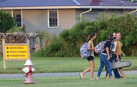 Students arrive for the first day of school in the Colonel Crawford district on Tuesday.