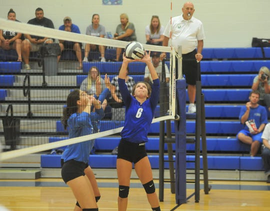 Crestline's Hannah Delong sets a teammate at the net.
