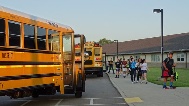 Colonel Crawford students head into the building as a new school year gets started Tuesday.