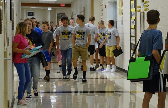 Colonel Crawford students walk down a hallway as classes started Tuesday.