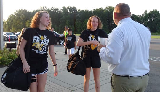Colonel Crawford High School Principal Jake Bruner greets students arriving for the first day of school on Tuesday.