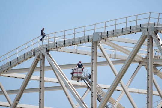 Corpus Christi police and fire department respond to a man on top of the Harbor Bridge on Tuesday, Aug. 20, 2019.
