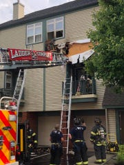 Cherry Hill firefighters respond to a townhouse blaze at the Bishop's View complex on Route 70 Monday afternoon. A lightning strike sparked the fire, which displaced the home's resident.