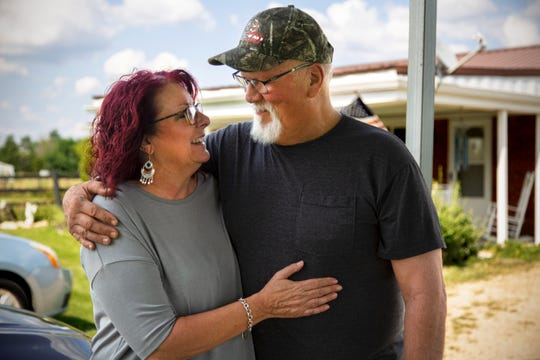 Scarlet and her husband, Bob Hudson, have a quiet moment outside their Southeast Indiana home.
