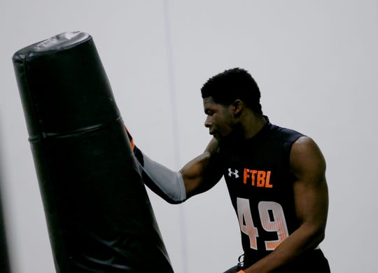 Winton Woods defensvie end Andrew Booker competes in pass rush drills  during the Under Armor All Amercian  Camp in Cincinnati, Sunday, April 14,2019.