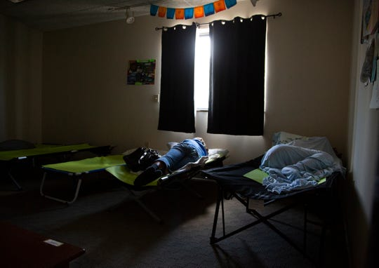 A woman rests at Women of Alabaster in the West End, which is open to drug-addicted, human-trafficked women of the streets for food, a rest, a change of clothes and prayer.