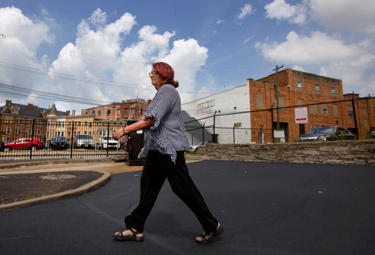 Scarlet Hudson walks through an Over-the-Rhine Shell Station where she went to help a distressed woman.