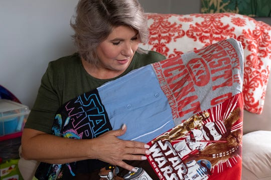 Katie Renfrow shows a quilt made from her son's t-shirts in her Westwood home and talks about the grief she's endured since her son, Samuel Gillman, died from an overdose. Samuel, 24, died from a heroin and fentanyl overdose on July 22, 2017. Now, two years later, Katie Renfrow is coping with the possibility that the man suspected of selling her son drugs will be convicted and sentenced.