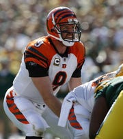 The Cincinnati Bengals quarterback Carson Palmer takes a snap against the Green Bay Packers at Lambeau Field, September 20, 2009.