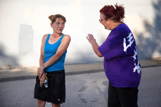 Scarlet Hudson talks to Summer, a woman staying under a bridge in the West End with her boyfriend, while doing outreach.