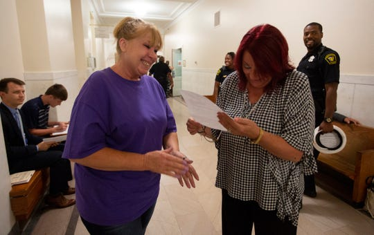 Roberta smiles and tears up as she shares a document that shows her criminal record has been sealed by Hamilton County Municipal Court Judge Heather Russell.