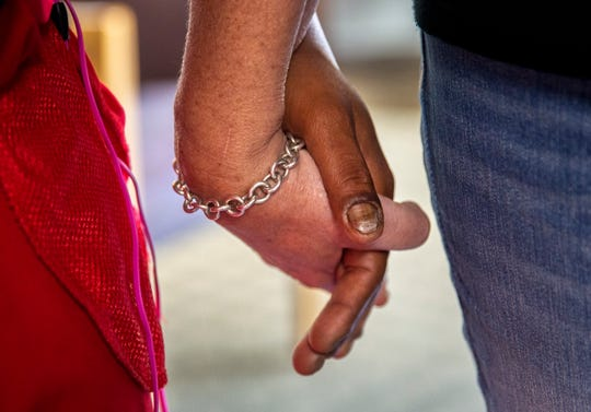 """Holding the hand of a woman before she heads back to the streets, Scarlet bows her head and a volunteer prays: 'Father, I thank you for bringing these ladies here today..."""""""