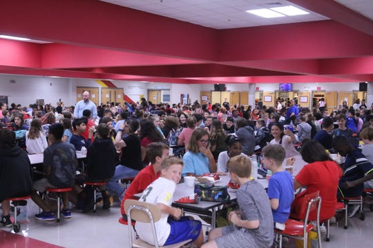 7th graders at Rossview Middle School crowd into the cafeteria for lunch on August 15, 2019.