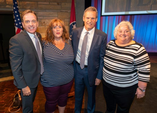 Tourist Development Commissioner Mark Ezell, Visit Clarksville Sales Director Frances Manzitto, Gov. Bill Lee and Visit Clarksville Executive Director Theresa Harrington at the governor's announcement of the 2018 economic impact of travel on Tennessee.