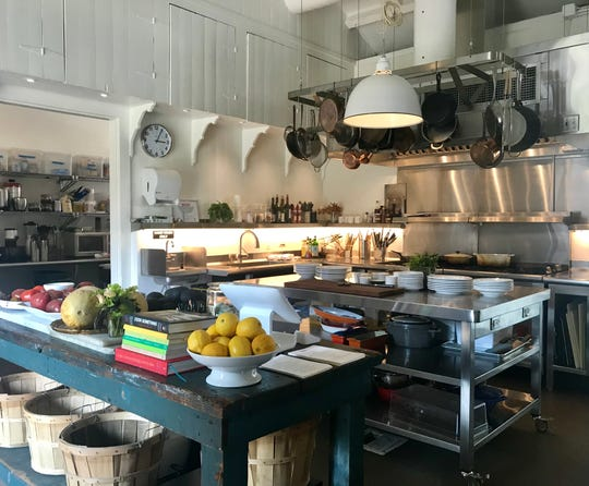 The open kitchen inside the cafe area of Canal House Station restaurant in Milford.
