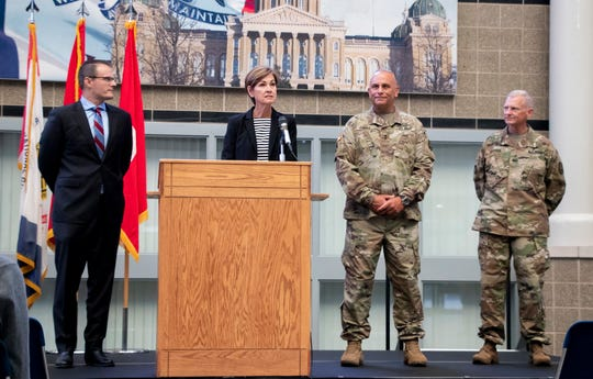 Gov. Kim Reynolds on Tuesday, Aug. 20, 2019, named Maj. Gen. Ben Corell, second from right, as adjutant general of the Iowa National Guard during a news conference at Camp Dodge in Johnston.
