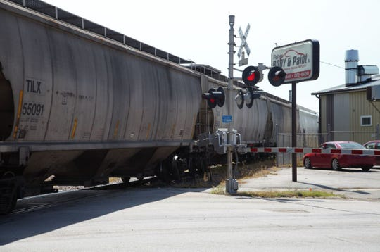 A Union Pacific train travels north across Hubbell Avenue on Tuesday afternoon in Des Moines. The week before, trains had blocked that intersection for hours at a time.