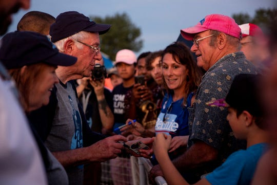U.S. Sen. Bernie Sanders, I-Vt., signs autographs after playing a softball game at the Field of Dreams on Monday, Aug. 19, 2019, in Dyersville.