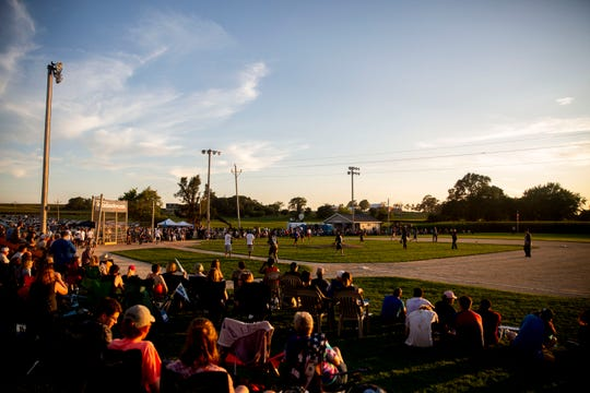 A the sun sets, a softball game hosted by U.S. Sen. Bernie Sanders, I-Vt., is played on the Field of Dreams on Monday, Aug. 19, 2019, in Dyersville.