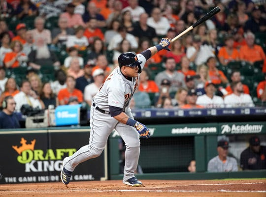 Detroit Tigers' Miguel Cabrera hits a run-scoring single during the first inning against the Houston Astros, Aug. 19, 2019, in Houston.