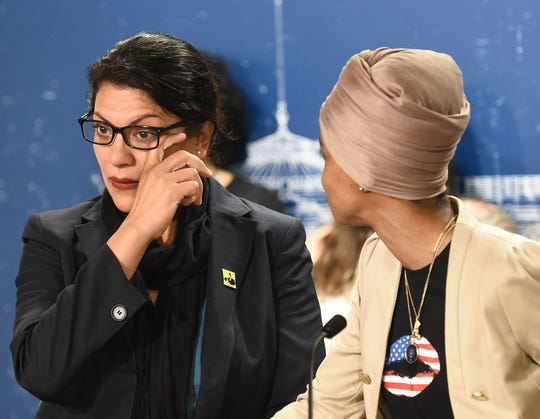 Democratic Representative from Michigan Rashida Tlaib, left, wipes away a tear while she became emotional talking about her family as Democratic Representative from Minnesota Ilhan Omar, right, looks on during a news conference at the Minnesota state capitol in St. Paul, Minnesota on Aug. 19, 2019.,