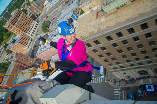 Leader Dogs for the Blind's Double Dog Dare event sends supporters rappelling down a building to raise program funds.