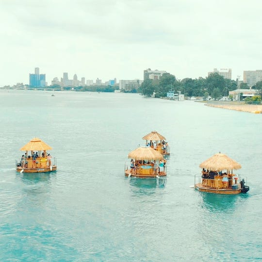 A fleet of tiki boats operated by Aloha Tiki Tours shown on the Detroit River in undated 2019 photo.