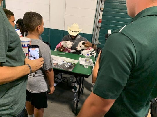 Michigan State cornerback Josh Butler with his dogs Remi and Roxy on Aug. 19, 2019 at Spartan Stadium.